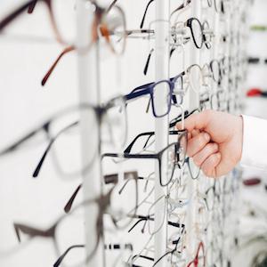 Man in a glasses. Guy in a optics shop