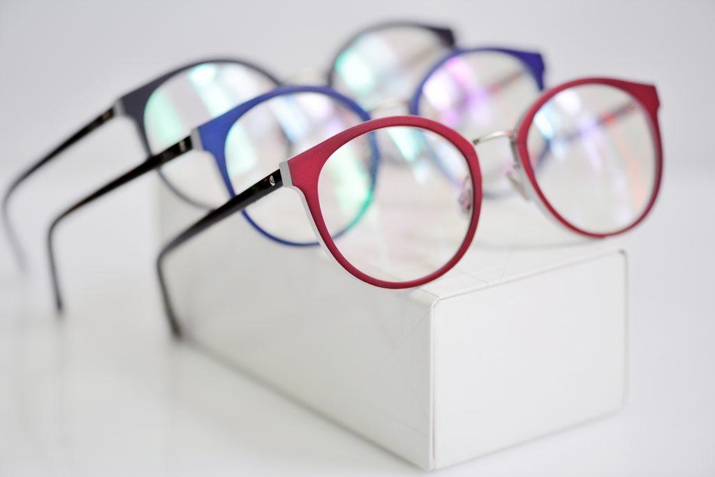 Multicolored fashionable glasses on a white case